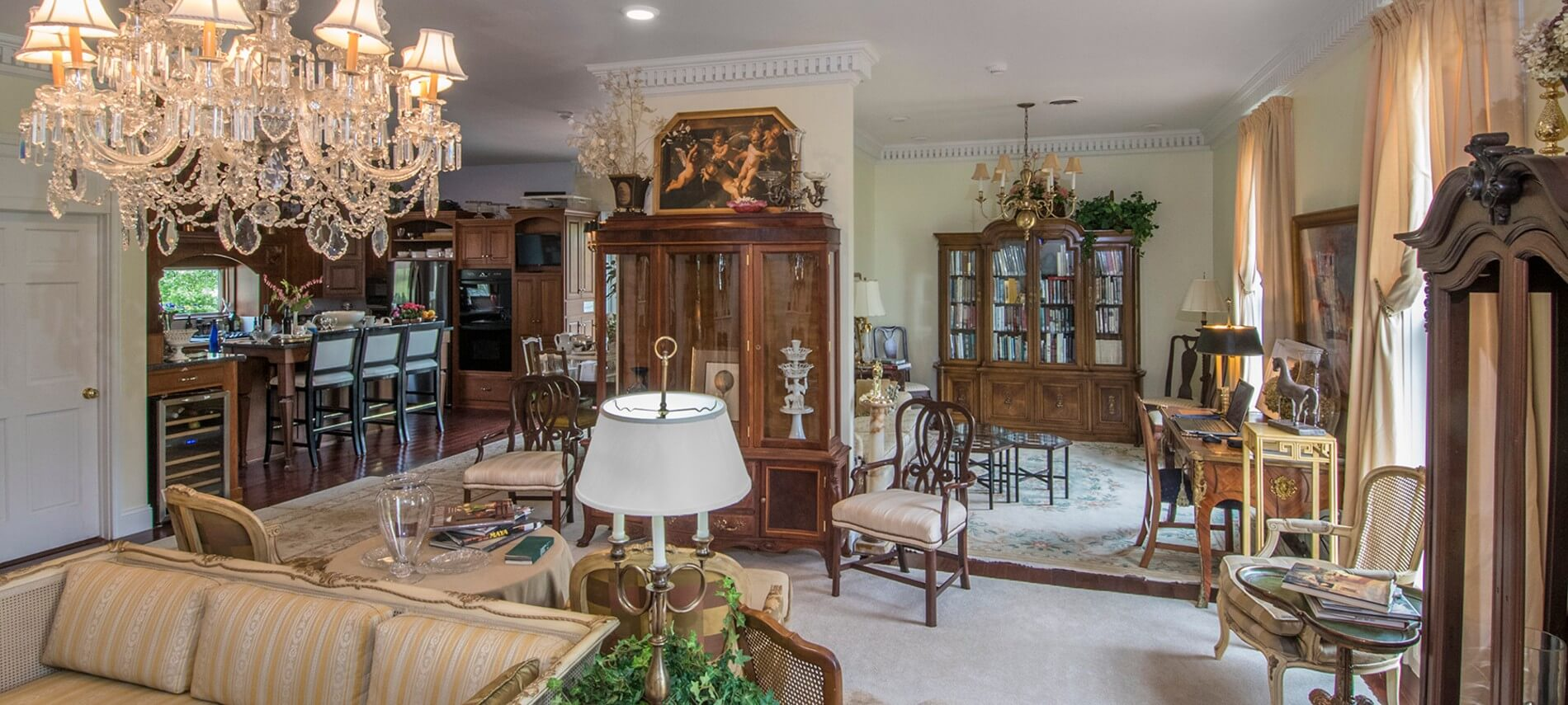 Kitchen and living rooms filled with antique furniture and art pieces.